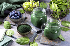 Green smoothie. With spirulina,spinach and blueberries Stock Photography