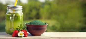 Green smoothie with spirulina. On wood background Stock Image
