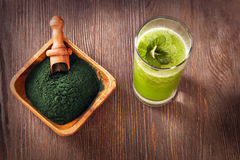 Green smoothie with spirulina on wood background.  Royalty Free Stock Photo