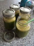 Green Smoothie with staw in glass jar. Fresh Royalty Free Stock Images