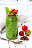 Green smoothie with superfoods. Matcha green tea chia seeds pudding stock photo