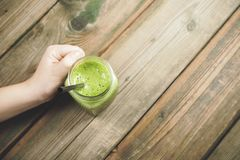 Green smoothie on the table Stock Photos