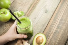 Green smoothie on the table Royalty Free Stock Photo