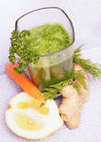 Green Smoothie top view. Green smoothie with carrot, lemon, parsley and ginger, top view Stock Photo