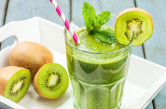Green smoothie on a tray with kiwi Royalty Free Stock Photo