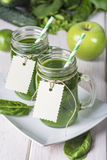 Green smoothie on a white wooden background Royalty Free Stock Photography