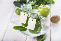 Green smoothie on a white wooden background Stock Images