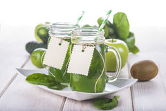 Green smoothie on a white wooden background Stock Image