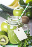 Green smoothie on a white wooden background Stock Photo