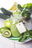 Green smoothie on a white wooden background Royalty Free Stock Photos