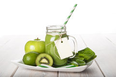 Green smoothie on a white wooden background Stock Photography