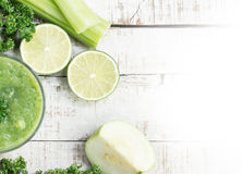 Green smoothie witn celery stalk, guava, lime, greenery Stock Photography