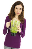 Green smoothie woman  looking disgusted Royalty Free Stock Photo