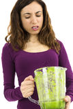 Green smoothie woman looking unhappy Stock Photography