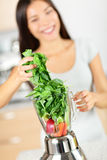 Green smoothie woman making vegetable smoothies Stock Photos