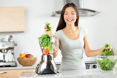 Green smoothie woman making vegetable smoothies Royalty Free Stock Photography