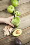 Green smoothie on wooden table Stock Image