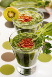 Green smoothies. Fresh green smoothies with fruits and vegetables Royalty Free Stock Image