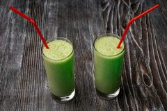 Green smoothies in glasses royalty free stock photo