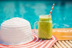 Green smoothies of spinach and banana on the background of the pool. Healthy food, healthy smoothies.  stock images