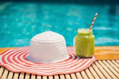 Green smoothies of spinach and banana on the background of the pool. Healthy food, healthy smoothies.  royalty free stock photo