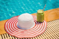 Green smoothies of spinach and banana on the background of the pool. Healthy food, healthy smoothies.  royalty free stock photography