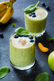 Green smoothies with spinach, blueberry and chia seeds Stock Photo
