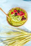 Green smoothies with spirulina bowl, pears, kiwis and berries, r Stock Images