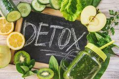 Green smoothies with vegetables and fruits. Detox Day. Slimming and excretion of slag. Healthy eating. Selective focus royalty free stock image