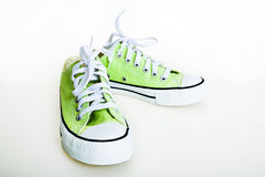 Green sneakers Stock Images