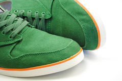 Green sneakers. With orange line on white background Stock Image