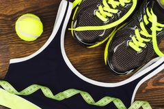 Green sneakers, ball and sports bra Stock Image