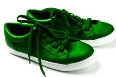 Green sneakers isolated on white. Close up pair of green sneakers isolated on white Stock Image