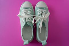 Green Sneakers on Purple 1 royalty free stock photo