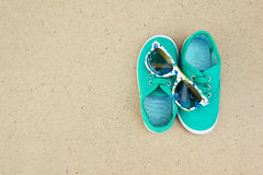 Green sneakers and sunglasses stock images
