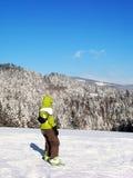 Green snowboarder Stock Photo
