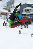 Green snowboarder fly stock photo