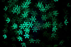Green  snowflake bokeh in the dark. Stock Photography