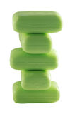 Green soap. A pyramid from the green pieces soap on a white background Stock Photos