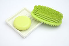 Green Soap in soap-dish with green rubber brush Royalty Free Stock Photography