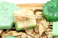 Green soaps. Scented glycerin soaps on a wooden board Royalty Free Stock Image