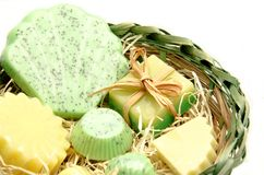 Green soaps. Scented glycerin soaps on a wooden basket Royalty Free Stock Photo