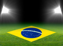 Green soccer field, brazil flag Stock Photo