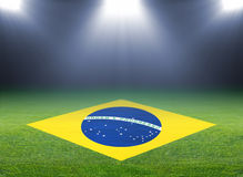 Green soccer field, brazil flag Royalty Free Stock Image