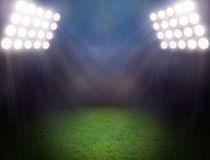 Green soccer field, bright spotlights Stock Image