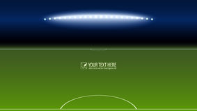 Green soccer field from the goalkeeper area with the spotlights with copy-space for your text or message. Lighted Royalty Free Stock Images