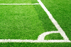 Green soccer field grass and white corner line Stock Images