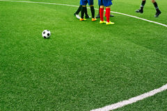 Green soccer field grass with white mark line and the boys play football background. Green soccer field grass with white mark line Stock Photography