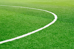 Green soccer field grass with white mark line Royalty Free Stock Photo