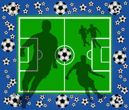 Green soccer field with player silhouettes Royalty Free Stock Photo